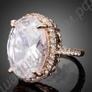 Эффектное позолоченное кольцо с огромным фианитом и россыпью мелких фианитов вокруг