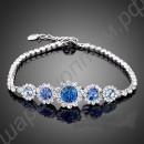 Изящный браслет с голубыми, синими и белыми фианитами, покрытый белым золотом