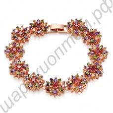 Запоминающийся позолоченный браслетик с цветочками из разноцветных фианитов
