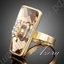 Блестящее асимметричное позолоченное кольцо с крупным тёмно-жёлтым камнем