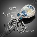 Великолепная брошь в виде осьминожки, усыпанной белыми и голубыми камушками