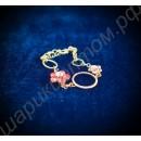Браслет с двумя цветочками из кристаллов сваровски и кольцами, покрытый золотом