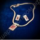 Шикарный комплект украшений, состоящий из подвески, цепочки и серёг с кубическими крупными циркониями, покрытый золотом